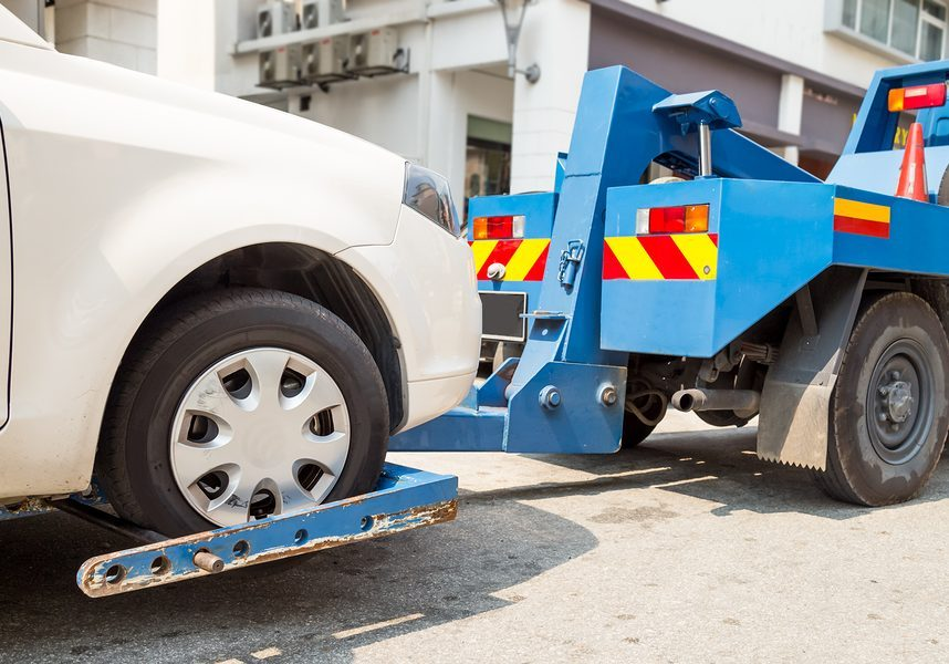 this image shows a car towing by cheap towing for manteca towing pros